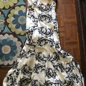 Black and white formal one shoulder with roses.